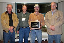 Rob Miskosky receives 10th Anniversary plaque from writers Duane Radford, T.J. Schwanky (l-r) and Don Meredith (r).